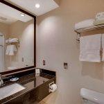 bathroom vanity in hotel room at Best Western Plus The Inn at Hampton